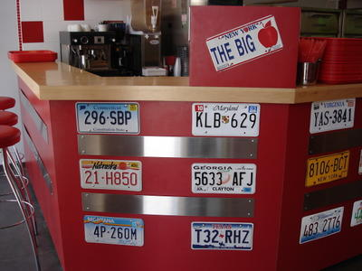 License plate display at Big Apple Pizza in Jerusalem