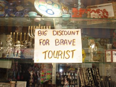 "Sign in gift store on the pedestrian mall downtown: ""Big discount for brave tourist"""