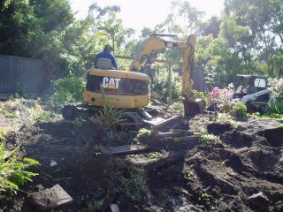 Excavator and Bobcat digging at our house