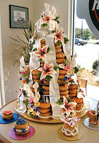Nina Torres of Cakes Plus in Tampa created this Krispy Kreme Doughnuts cake, a pyramid adorned with ribbons and flowers.