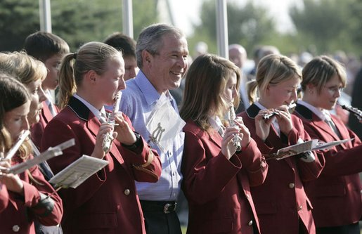 President George W. Bush joins members of the Jagdhornblaser Baremerhagen Band Thursday, July 13, 2006, prior to dinner in Trinwillershagen, Germany. The President and Mrs. Laura Bush depart Germany Friday for Russia and the G8 Summit. White House photo by Eric Draper.