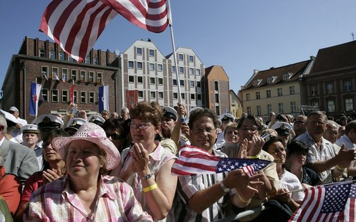 People crowd the town square of Stralsund, Germany, as Chancellor Angela Merkel welcomes President George W. Bush and Laura Bush Thursday, July 13, 2006.