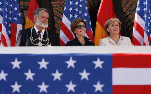 Mrs. Laura Bush is seated between Stralsund Mayor Harald Lastovka and German Chancellor Angela Merkel during the welcoming ceremony Thursday, July 13, 2006, in honor of the visit by President George W. Bush and Laura Bush to Stralsund, Germany. White House photo by Eric Draper.