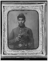 Seated black soldier with pistol and jacket, Library of Congress, Prints & Photographs Division, REPRODUCTION NUMBER: LC-USZ62-132209