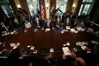 President George W. Bush is joined by members of his cabinet as he speaks with news reporters, Tuesday, Sept. 6, 2005, in the Cabinet Room at the White House. White House photo by Paul Morse