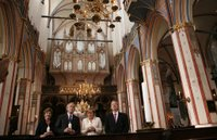 President George W. Bush and Laura Bush stand with German Chancellor Angela Merkel and Pastor Peter Neumann in St. Nikolai Church in Stralsund, Germany, Thursday, July 13, 2006. White House photo by Paul Morse.