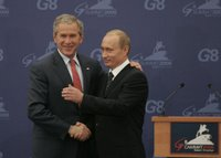 President George W. Bush and President Vladimir Putin exchange handshakes Saturday, July 15, 2006, after a joint press availability at the International Media Center in the Konstantinovsky Palace Complex, site of the G8 Summit in Strelna, Russia. White House photo by Paul Morse.