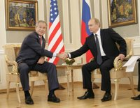 President George W. Bush and Russia's President Vladimir Putin shake hands before their G8 bilateral meeting Saturday, July 15, 2006, at the Konstantinovsky Palace Complex in Strelna, Russia. White House photo by Eric Draper.