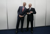 President George W. Bush and President Vladimir Putin of Russia, pose briefly for photographers before their joint press availability Saturday, July 15, 2006, during the G8 Summit in Strelna, Russia. White House photo by Eric Draper.