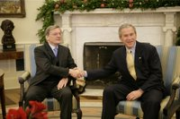 President George W. Bush and Austria Chancellor Wolfgang Schuessel exchange handshakes during the Chancellor's visit Thursday, Dec. 8, 2005, to the White House. White House photo by Eric Draper