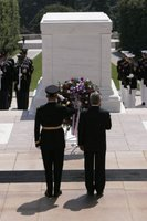 President George W. Bush stands with U.S. Army Major General Guy Swan during the Memorial Day wreath laying ceremony at the Tomb of the Unknowns in Arlington Cemetery in Arlington, Va. Monday, May 29, 2006. White House photo by Paul Morse