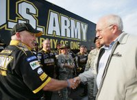 Vice President Dick Cheney meets members of the U.S. Army NASCAR racing team July 1 while attending the 2006 Pepsi 400 NASCAR race at Daytona International Speedway in Daytona, Fla. White House photo by David Bohrer.