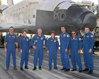 The crew of mission STS-114 gathered in front of Discovery following landing at Edwards Air Force Base. From left to right: Mission Specialist Stephen Robinson, Commander Eileen Collins, Mission Specialists Andrew Thomas, Wendy Lawrence, Soichi Noguchi and Charles Camarda, and Pilot James Kelly. (Image Credit: Jim Ross/NASA)