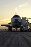 The sun rises on the Space Shuttle Discovery as it rests on the runway at Edwards Air Force Base, California, after a safe landing August 9, 2005 to complete the STS-114 mission. (Image Credit: Carla Thomas/NASA)