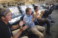 Mission managers applaud the successful landing of Space Shuttle Discovery at Edwards Air Force Base in California. (Image Credit: Bill Ingalls/NASA)