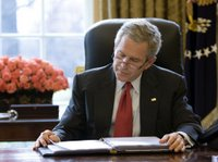 President George W. Bush reads over a draft of his State of the Union speech in the Oval Office Tuesday morning, Jan. 31, 2006, in preparation for the annual address to the nation scheduled for this evening. White House photo by Eric Draper.
