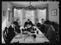 Saying grace before carving the turkey at Thanksgiving dinner reproduction number, LC-USW3-011874-D DLC
