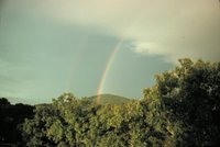 A primary and secondary rainbow - note reversal of spectrum Reversal caused by second bow being produced by 2 internal reflections, Image ID: wea00141, Historic NWS Collection, Location: View NE from Asheville, North Carolina, Photo Date: September 1975, Photographer: Grant W. Goodge.