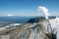 MSH05_aerial_st_helens_adams_from_west_02-25-05.jpg Aerial view of a steaming Mount St. Helens with Mount Adams in the background. USGS Photograph taken on February 25, 2005, by Mike Doukas and Julie Griswold.