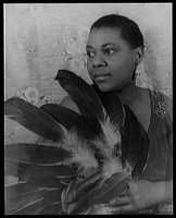 Bessie Smith holding feathers, Credit Line: Library of Congress, Prints & Photographs Division, Carl Van Vechten Collection, [reproduction number, e.g., LC-USZ62-54231]