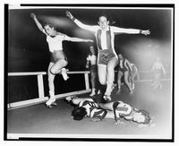 Two women's league roller derby skaters leap over two who have fallen, Library of Congress, Prints and Photographs Division, [REPRODUCTION NUMBER: LC-USZ62-133382)