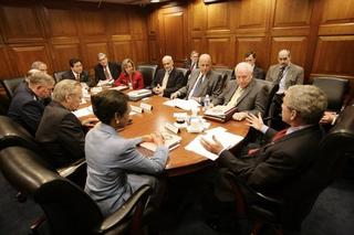President George W. Bush offers remarks after a briefing by Fran Townsend, in red, Assistant to the President for Homeland Security and Counterterrorism, to the National Security Council regarding the Silberman-Robb Weapons of Mass Destruction Commission Report Wednesday, June 29, 2005, in the Situation Room of the White House. White House photo by Eric Draper