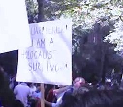"Sign reads: ""Liar! Denier! I am a Holocaust Survivor"""