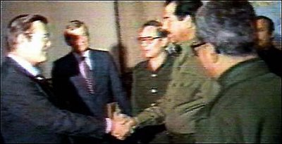 Donald Rumsfeld and Saddam Hussein shake hands