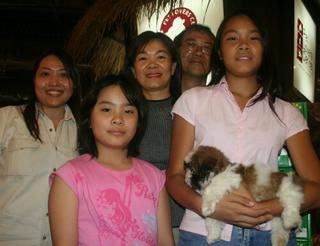 Goh family with new puppy