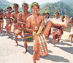 Bontoc students in their colorful costumes dance the traditional way as they join nine other tribes in the Mt. Province during yesterday's celebration of the 'Lang-ay' festival, the traditional way of sharing happiness and festivities to strenghten family ties.
