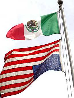 The Mexican Flag is displayed above the American flag. The American Flag is displayed upside down, a sign of distress.