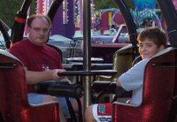 Dave and Tyler riding the Tornado