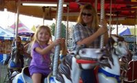 Shan and Emily on the carousel
