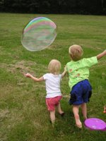Kids Chasing a Big Bubble