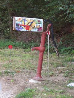 Old water pump holding up mailbox