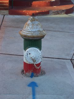 Fire hydrant painted in the colors of the Italian flag