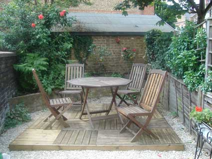 Nice shiny decking and garden furniture