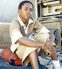 Walt (Malcolm David Kelley)