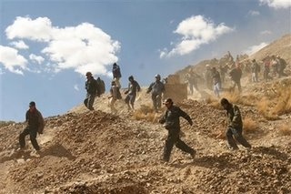 Miners working for the state run company COMIBOL run away from a stick of dynamite that has just been hurled at them