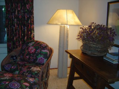 Chair, ottoman, window coverings