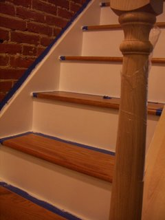 staircase taped for riser painting