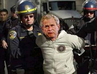 Bush doing the perp walk. Visualization leads to actualization. Read the article where this picture was found at http://www.uruknet.info/?p=14599.