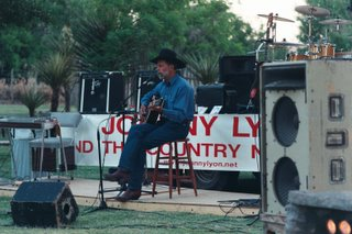 Cowboy singer at Texas barbecue, Cibolo Ranch, Texas, May, 2002
