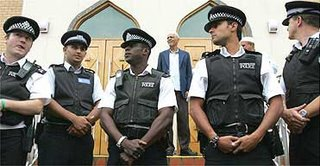 Police officers outside the Masjid-E-Umer mosque in Walthamstow. Photograph: Toby Melville/Reuters - From the Guardian