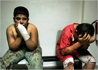 Two brothers from the Shaito family waited Sunday at a hospital in Tyre, Lebanon. Three of their relatives died while fleeing north when their van was struck by an Israeli missile. (New York Times, 7/23/06)