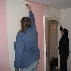 Our pink bedroom being painted cream.