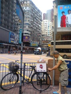old man with washington apple box on his bike, hong kong. click for big version