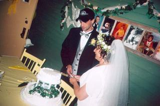 Al, Stacy, and the wedding cake-by Joe Blades 2005