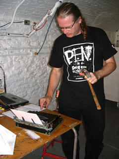 Joe typing with hammer