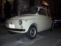 Our Fiat 500F, newly purchased, street parked in Milan's Navigli district